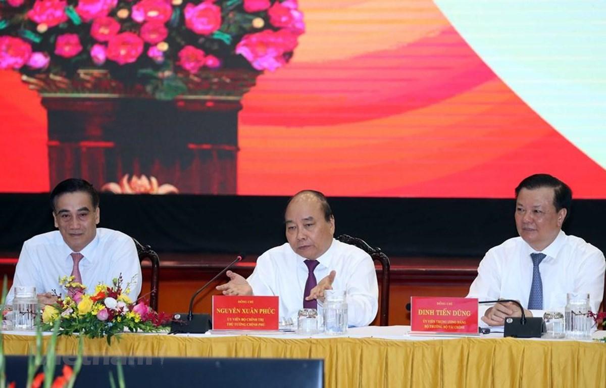 Thủ tướng Nguyễn Xuân Phúc dự Hội nghị sơ kết công tác tài chín, ngân sách Nhà nước 6 tháng đầu năm và triển khai nhiệm vụ 6 tháng cuối năm 2020. (Ảnh: Thống Nhất/TTXVN)