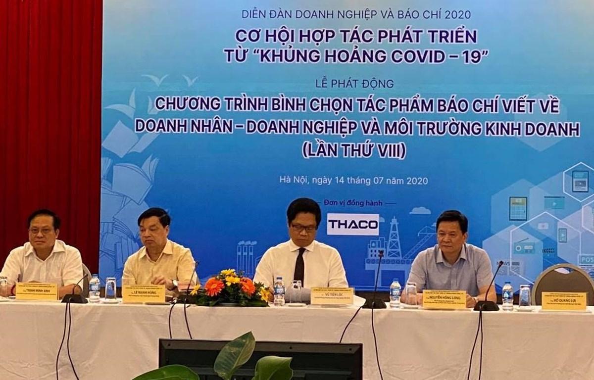"""Diễn đàn Doanh nghiệp và Báo chí 2020: Cơ hội hợp tác phát triển từ """"khủng hoảng COVID-19."""" (Ảnh: PV/Vietnam+)"""