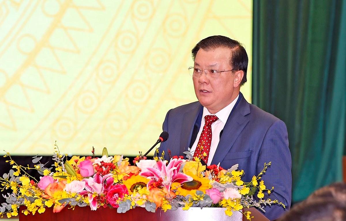 Bộ trưởng Bộ Tài chính Đinh Tiến Dũng phát biểu tại hội nghị, ngày 8/1. (Ảnh: Vietnam+)