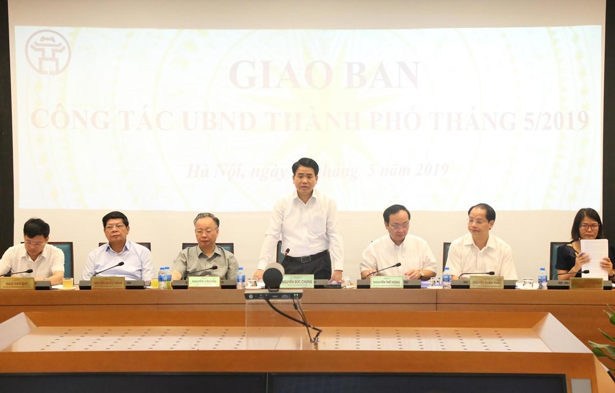 Chủ tịch UBND Hà Nội Nguyễn Đức Chung phát biểu tại phiên họp. (Ảnh: CTV/Vietnam+)