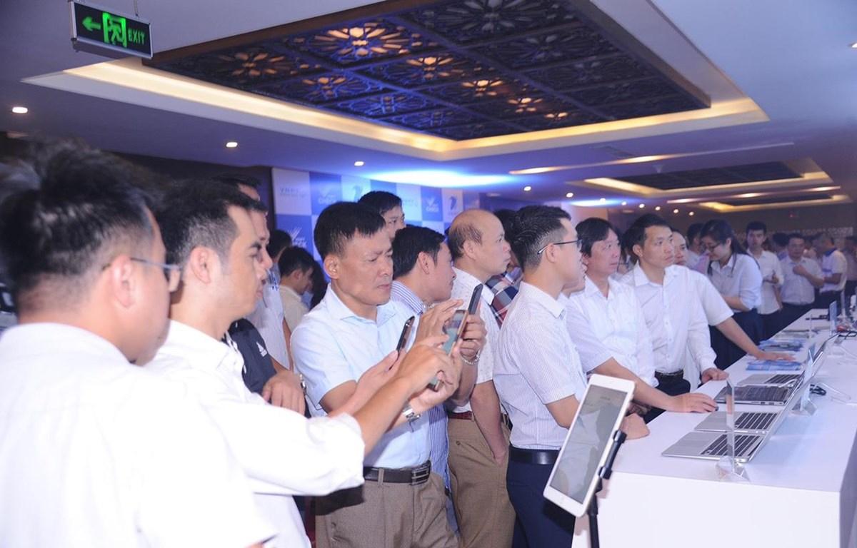 Các giải pháp chuyển đổi số của VNPT thu hút sự quan tâm của các đại biểu. (Ảnh: C.H/Vietnam+)