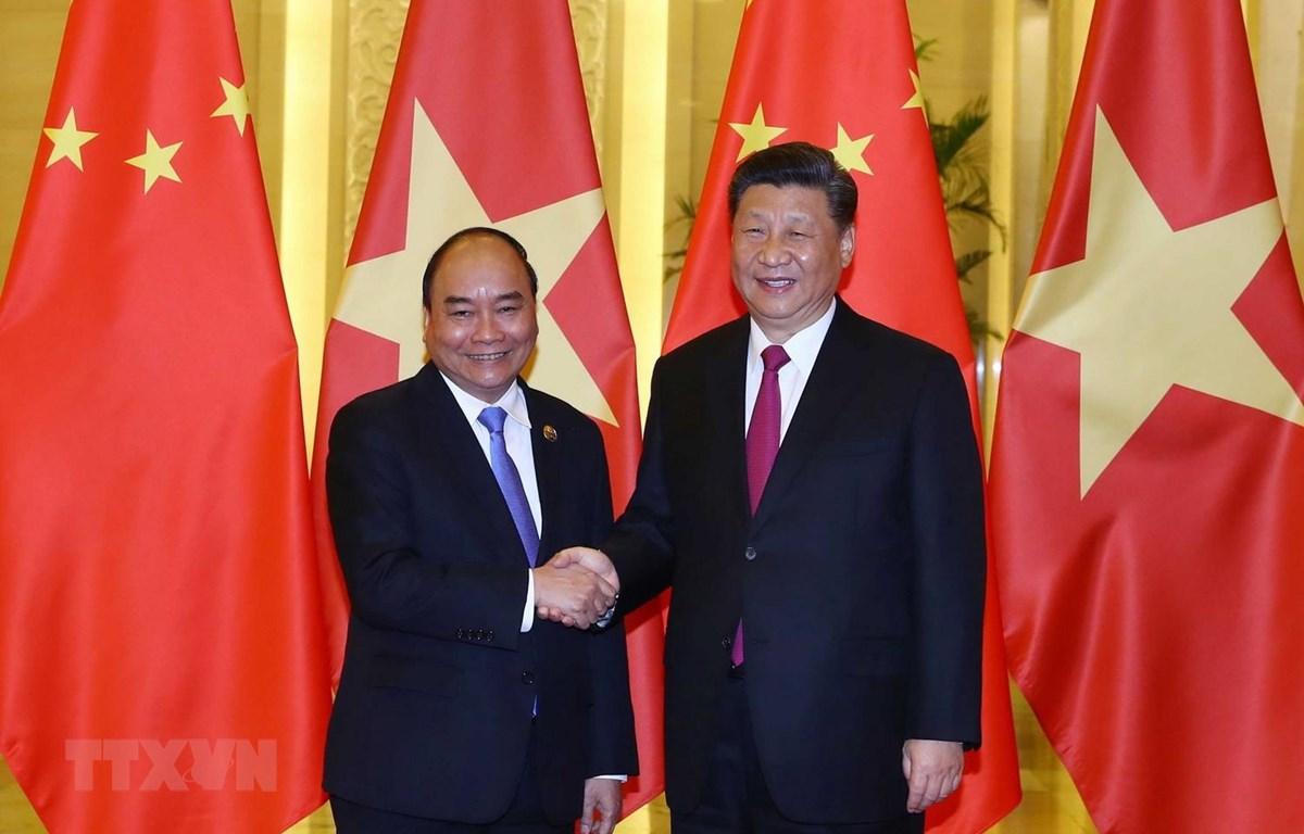 Thủ tướng Nguyễn Xuân Phúc hội kiến Tổng Bí thư, Chủ tịch nước Trung Quốc Tập Cận Bình. (Ảnh: Thống Nhất/TTXVN)