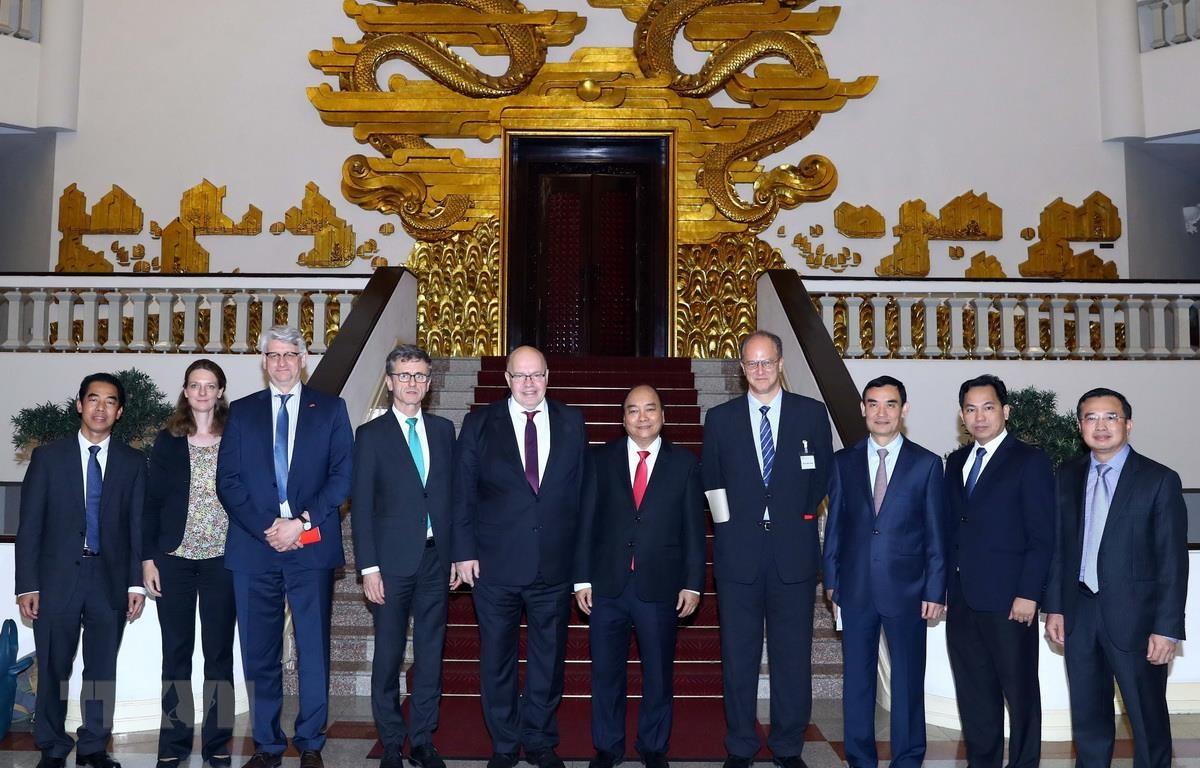 Thủ tướng Nguyễn Xuân Phúc tiếp Bộ trưởng Kinh tế và Năng lượng Đức Peter Altmaier. (Ảnh: Thống Nhất/TTXVN)
