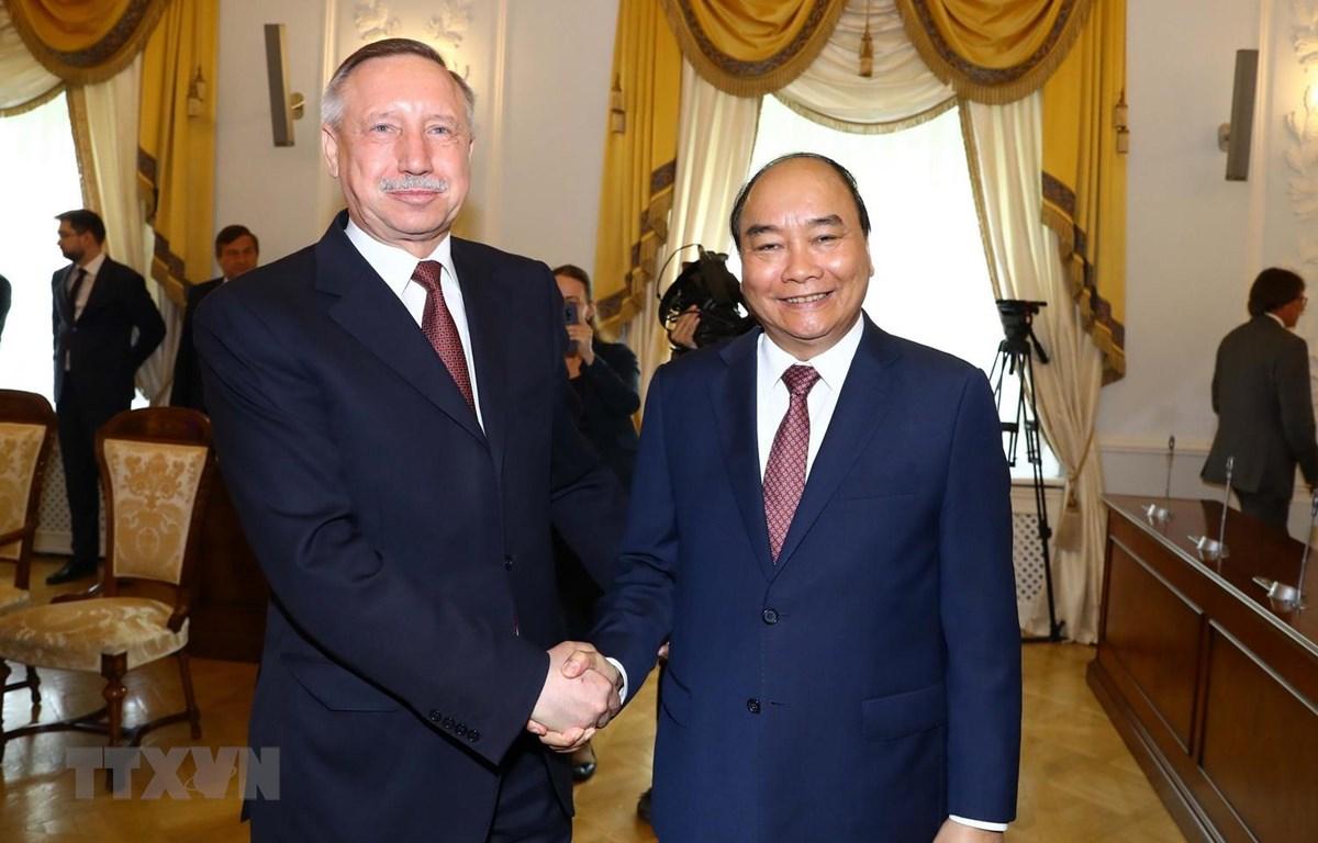 Thủ tướng Nguyễn Xuân Phúc gặp Quyền Thống đốc Saint Petersburg Beglov A.D. (Ảnh: Thống Nhất/TTXVN)