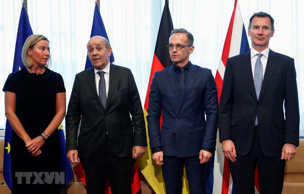 Đại diện cấp cao phụ trách an ninh và đối ngoại của Liên minh châu Âu (EU) Federica Mogherini, Ngoại trưởng Pháp Jean-Yves Le Drian, Ngoại trưởng Đức Heiko Maas và Ngoại trưởng Anh Jeremy Hunt. (Ảnh: AFP/TTXVN)