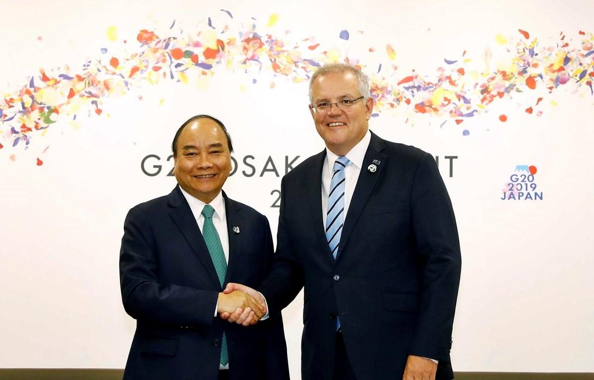 Thủ tướng Nguyễn Xuân Phúc gặp Thủ tướng Australia Scott Morrison ở G20, tổ chức tại thành phố Osaka của Nhật Bản. (Ảnh: Thống Nhất/TTXVN)