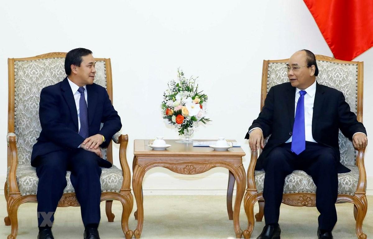 Thủ tướng Nguyễn Xuân Phúc tiếp Đại sứ Lào Sengphet Houngboungnuang. (Ảnh: Thống Nhất/TTXVN)
