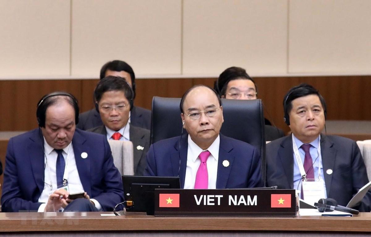 Thủ tướng Nguyễn Xuân Phúc và các thành viên Đoàn đại biểu cấp cao Chính phủ Việt Nam tham dự hội nghị. (Ảnh: Thống Nhất/TTXVN)