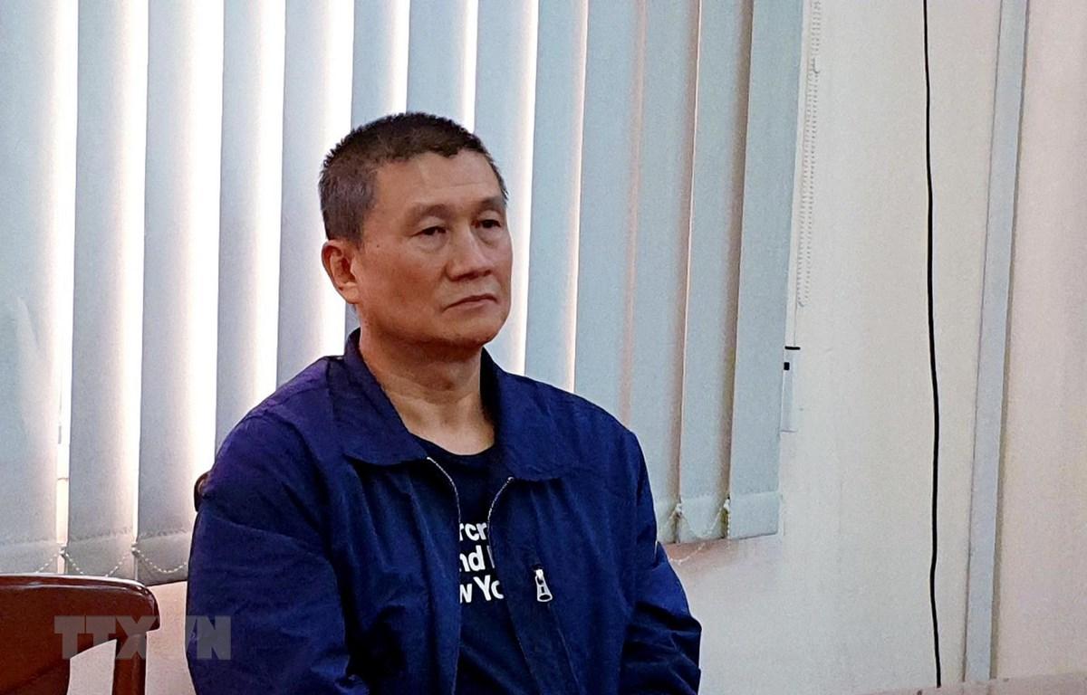 Đối tượng người Đài Loan trốn nã bị Bộ Công an Việt Nam bắt giữ. (Ảnh: Thành Chung/TTXVN)