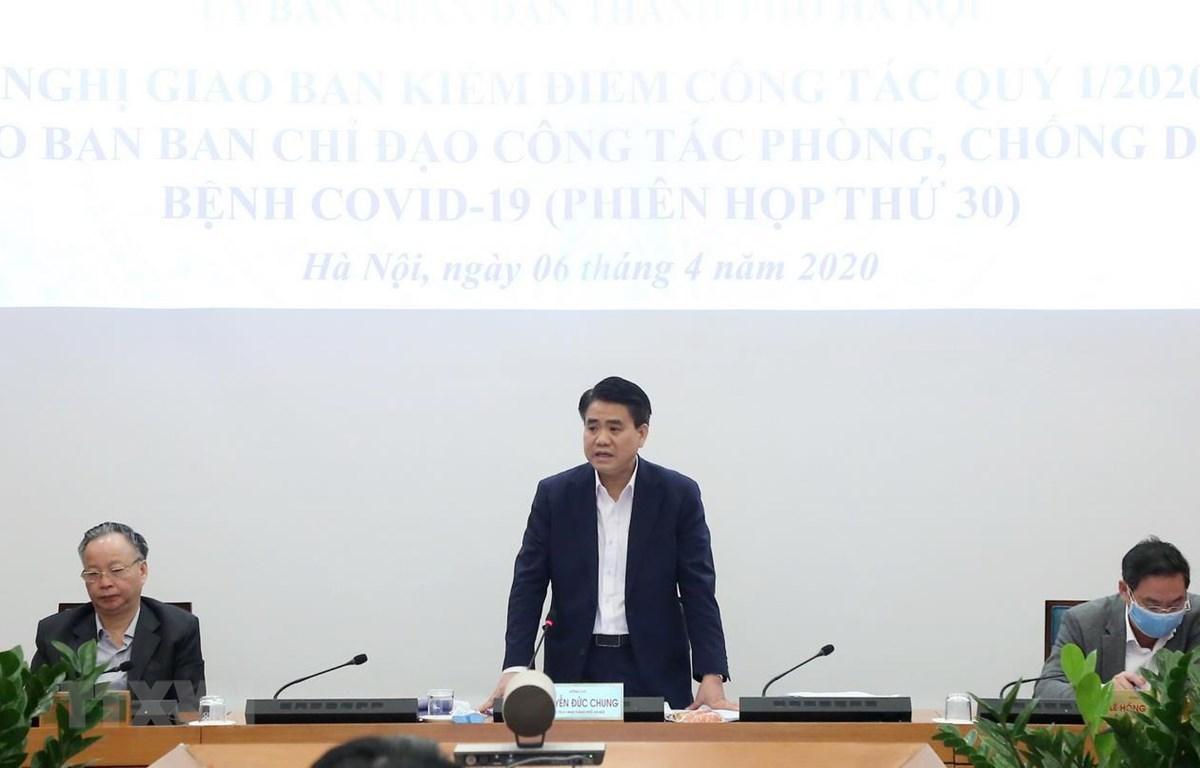 Chủ tịch UBND thành phố Hà Nội Nguyễn Đức Chung phát biểu kết luận phiên họp giao ban công tác quý 1 năm nay. (Ảnh: Lâm Khánh/TTXVN)