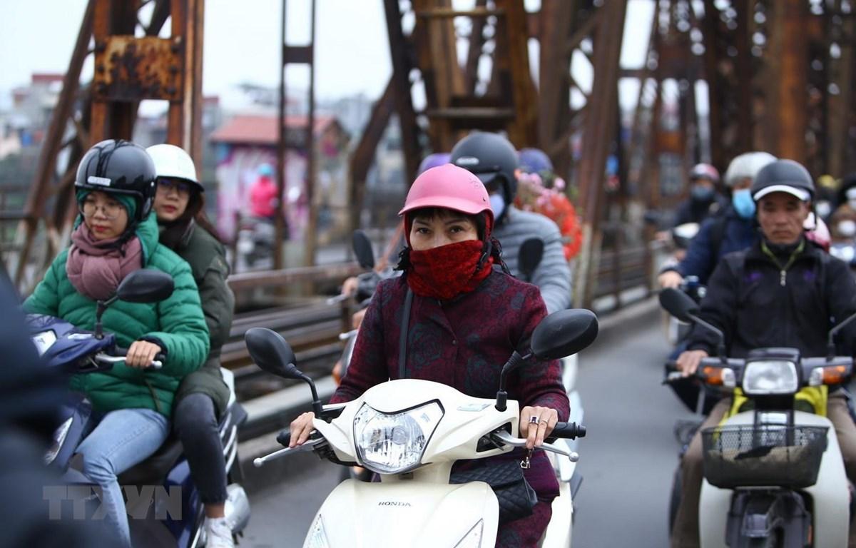 Nhiệt độ xuống thấp, trời lạnh ở Hà Nội. (Ảnh: Minh Quyết/TTXVN)