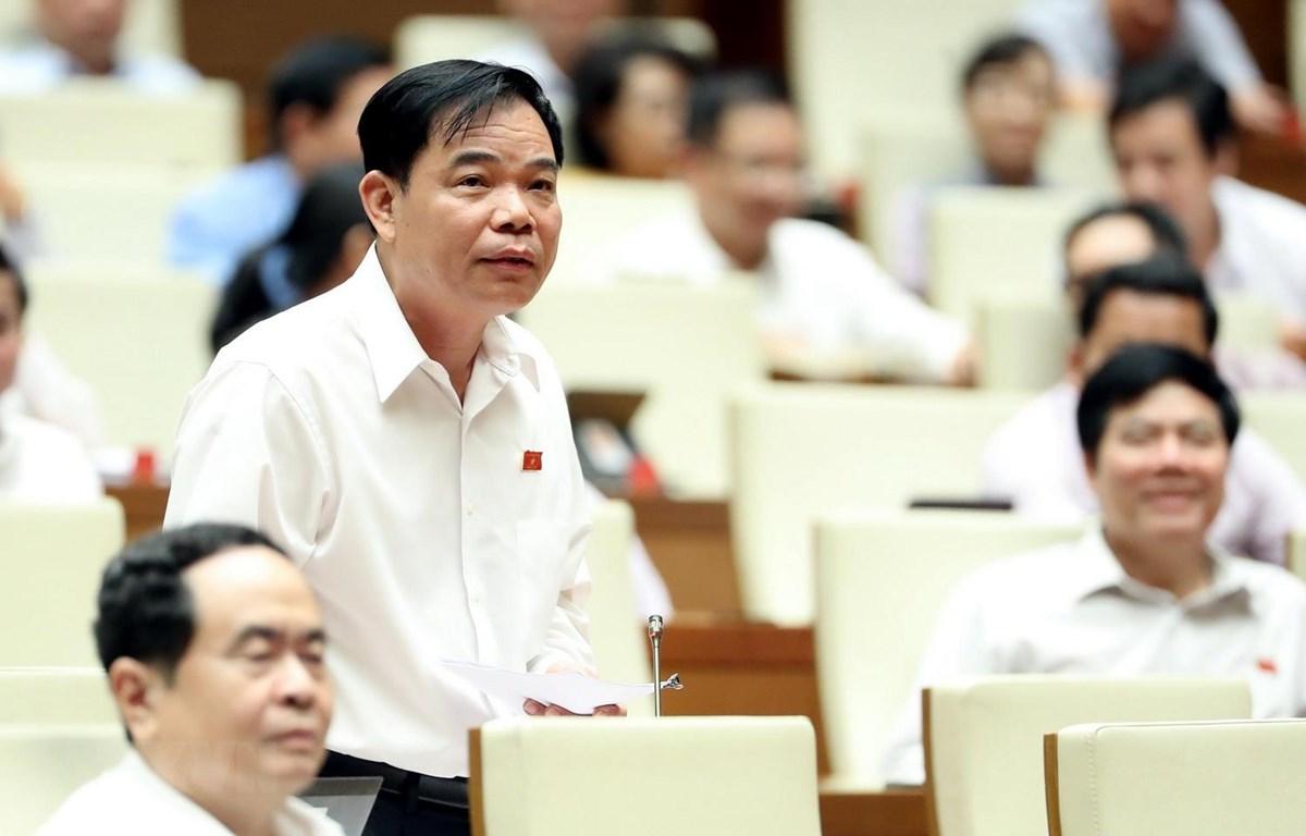 Bộ trưởng Bộ Nông nghiệp và Phát triển Nông thôn Nguyễn Xuân Cường giải trình, làm rõ một số vấn đề đại biểu Quốc hội nêu. (Ảnh: Trọng Đức/TTXVN)