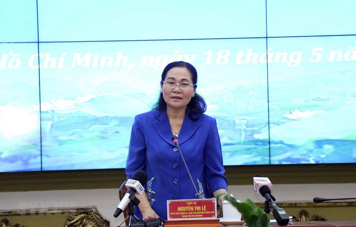 Bà Nguyễn Thị Lệ, Chủ tịch Hội đồng nhân dân Thành phố, Chủ tịch Ủy ban bầu cử Thành phố chủ trì Phiên họp. (Ảnh: Xuân Khu/TTXVN)