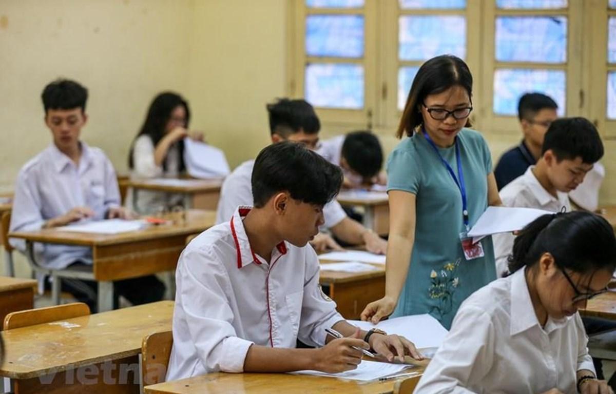 Thí sinh dự thi môn Ngữ văn, Kỳ thi Tuyển sinh vào lớp 10, tại Hà Nội, năm học 2019-2020. (Ảnh: PV/Vietnam+)