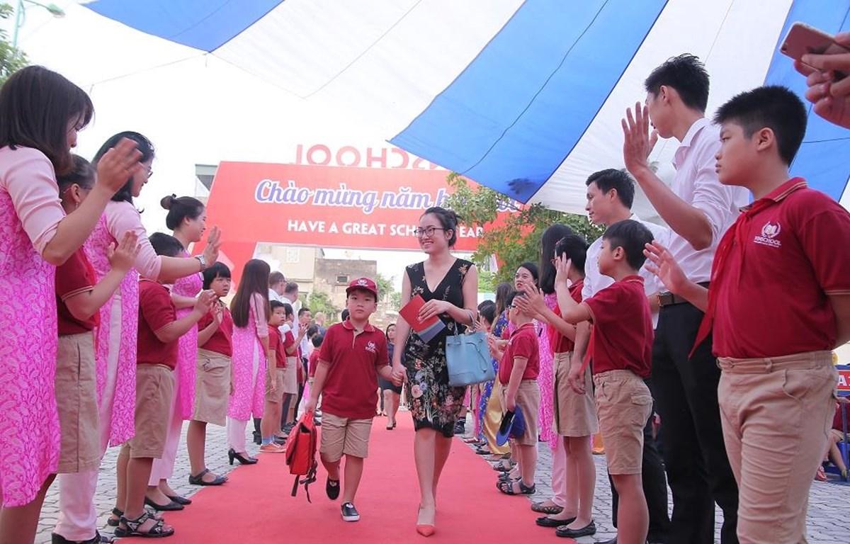 Niềm vui ngày khai trường. (Ảnh: PV/Vietnam+)