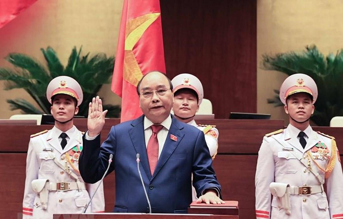 Chủ tịch nước Nguyễn Xuân Phúc tuyên thệ nhậm chức trước Quốc hội, đồng bào và cử tri cả nước. (Ảnh: Thống Nhất/TTXVN)