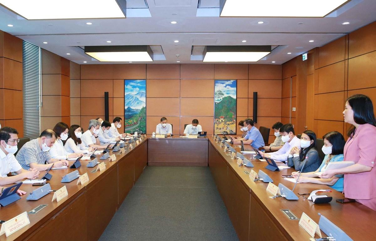 Các đại biểu thảo luận tại tổ chiều ngày 24/7. (Ảnh: Phương Hoa/TTXVN)