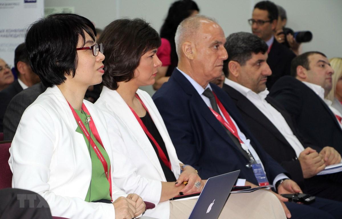 Phó Tổng giám đốc TTXVN Vũ Việt Trang dự phiên thảo luận do Hãng thông tấn TASS tổ chức. (Ảnh: Hồng Quân/TTXVN)