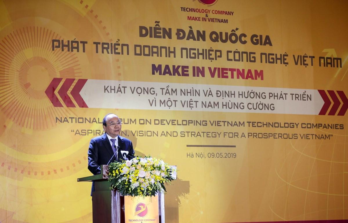 Thủ tướng Nguyễn Xuân Phúc phát biểu tại Diễn đàn quốc gia phát triển doanh nghiệp công nghệ Việt Nam. (Ảnh: Minh Sơn/Vietnam+)
