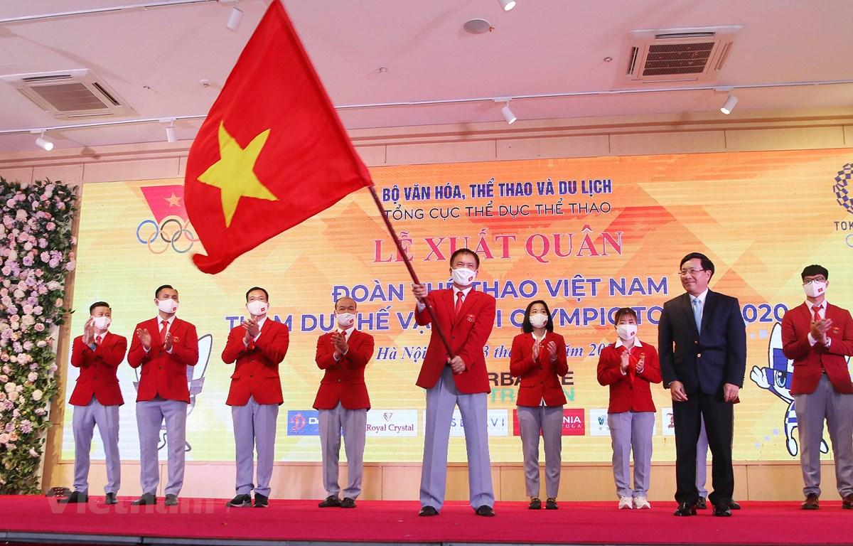 Lễ xuất quân Đoàn Thể thao Việt Nam tham dự Thế vận hội Olympic Tokyo tại Hà Nội diễn ra vào tối 13/7. (Ảnh: PV/Vietnam+)