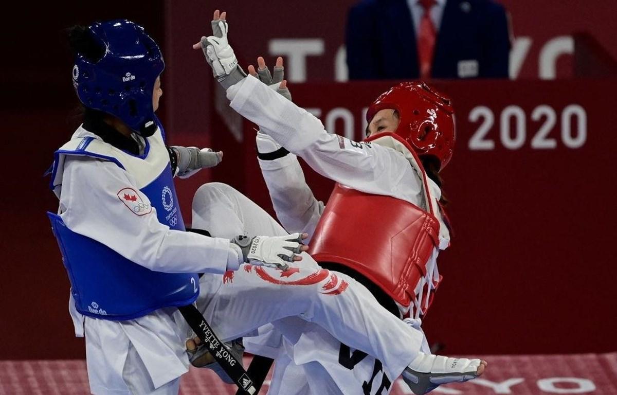 Vận động viên Kim Tuyền (giáp đỏ) áp đảo đối thủ. (Ảnh: Getty Images)