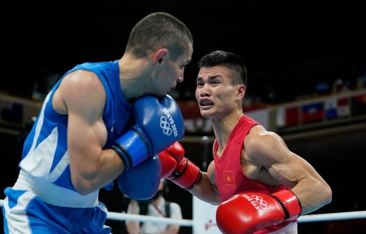 Nguyễn Văn Đương chia tay Olympic Tokyo 2020 với một chiến thắng đầu tiên trước tay đấm người Azerbaijan. (Ảnh: Getty Images)