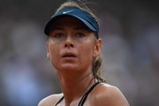 Roland Garros: Garbine Muguruza 'hạ gục nhanh' Maria Sharapova