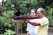 [Photo] Người duy trì môn bắn nỏ truyền thống của đồng bào vùng cao