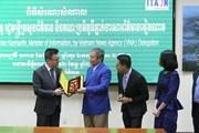 [Photo] Bộ trưởng Bộ Thông tin Campuchia tiếp Phó Tổng giám đốc TTXVN