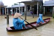 [Photo] Nước lũ đang xuống, nhiều vùng ở Thừa Thiên-Huế vẫn ngập sâu