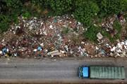 Hà Nội: Xuất hiện 'bãi rác khổng lồ' dưới chân cầu vượt An Khánh