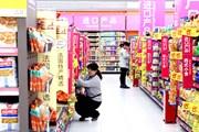 Trung Quốc: Chi cho tiêu dùng tăng thấp nhất trong 15 năm