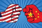Kinh tế toàn cầu chịu rủi ro từ cuộc chiến thương mại Mỹ-Trung