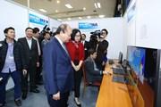 [Photo] Thủ tướng thăm Trung tâm Báo chí Hội nghị Thượng đỉnh Mỹ-Triều