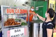 [Photo] Hàng quán tại Hà Nội mở cửa đón khách sau nới lỏng giãn cách