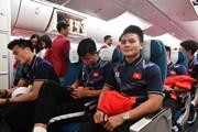 [Photo] Tuyển thủ bóng đá trên chuyến bay Vietnam Airlines về nước