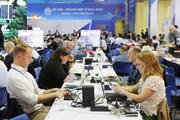[Photo] Phóng viên quốc tế tác nghiệp tại Trung tâm báo chí quốc tế