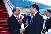 [Photo] Thủ tướng tới Trung Quốc dự Diễn đàn Vành đai và Con đường