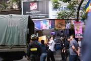 [Photo] Bộ Công an khám xét chuỗi cửa hàng điện thoại Nhật Cường