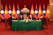 Tổng Bí thư hai nước Việt-Lào chứng kiến Lễ ký các văn kiện hợp tác