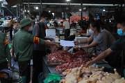 [Photo] Hà Nội: Chợ đầu mối Minh Khai tăng cường phòng, chống dịch