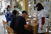 [Photo] Khai báo y tế bắt buộc tại ký túc xá Đại học Kinh tế Quốc dân