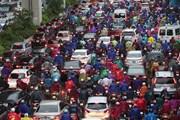 [Photo] Mưa to gây ùn tắc nhiều tuyến phố ở Hà Nội trong sáng 7/9