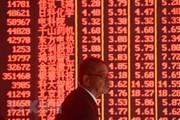Chứng khoán châu Á tiếp tục biến động vì bất ổn Mỹ-Trung