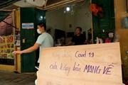 Hà Nội: Nhiều hàng quán thay đổi cách kinh doanh đề phòng COVID-19