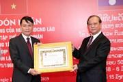 Hình ảnh TTXVN đón nhận các huân chương cao quý của Nhà nước Lào