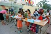 [Photo] Học sinh TP.HCM trở lại trường sau thời gian nghỉ phòng dịch