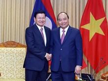 Hình ảnh hai Thủ tướng Việt-Lào chủ trì kỳ họp Ủy ban Liên Chính phủ