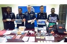 Một phụ nữ Việt bị bắt ở Malaysia vì tham gia đường dây lừa đảo