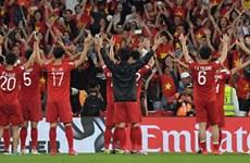 Cầu thủ Việt Nam hò hét ăn mừng sau khi giành vé vào vòng 1/8